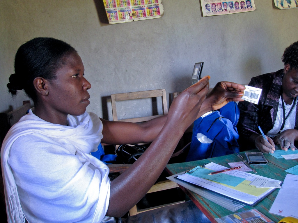 One of the CHWs scanning a patient barcode with the phone